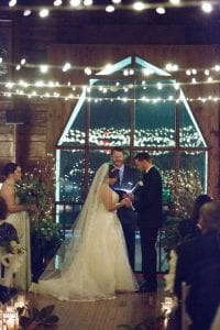 Bride and groom exchange vows at a Dairy Barn wedding