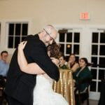 Bride dances with her father at her Dairy Barn wedding coordinated by Magnificent Moments Weddings