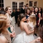 Bridal party dancing at Dairy Barn wedding to music by DJ Jim Wilke