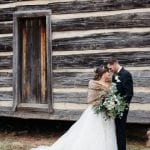 Bride and groom embrace following their wedding at The Dairy Barn captured by Grain and Compass