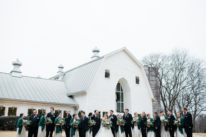 Bridal party pose outside of The Dairy Barn in images captured by Grain and Compass