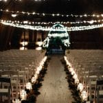 Candlelit reception space at The Dairy Barn for a New Years Even wedding captured by Grain and Compass