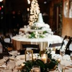 Stunning table setting for a New Years Eve wedding at the Dairy Barn captured by Grain and Compass