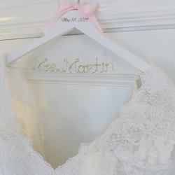 Custom bridal hanger shows off the brides new last name and wedding date for a sweet spring wedding coordinated by Magnificent Moments Weddings