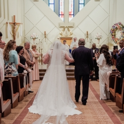 Bride is escorted down the aisle by her father to music provided by Elegant Ensembles during her wedding ceremony at St Gabriel's Catholic Church