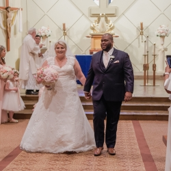 Bride and groom are all smiles as they leave their wedding ceremony at St Gabriel's Catholic Church as husband and wife