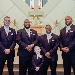 Groom poses with his groomsmen at St Gabriel's Catholic Church captured by Green Valley Photography