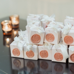 Sweet favor boxes show off the couples initial and were the perfect treat for their guest during a spring wedding coordinated by Magnificent Moments Weddings