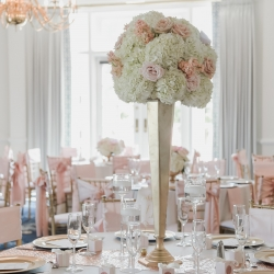 Lilly Greenthumbs created stunning centerpieces featuring white hydrangeas and soft pink roses all for a spring wedding at Providence Country Club