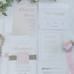 Green Valley Photograph captures a pink invitation suite for a couples spring wedding at Providence Country Club