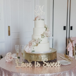 Green Valley Photography captures a stunning wedding cake by Celestial Cakes for a spring wedding coordinated by Magnificent Moments Weddings