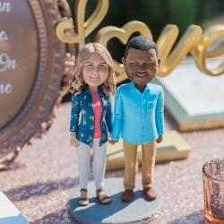 Custom bobble heads of the bride and groom were a fun addition to their guestbook table all coordinated by Magnificent Moments Weddings