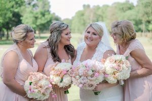 Bride poses with her bridesmaids for Green Valley Photography holding stunning floral bouquets created by Lily Greenthumbs