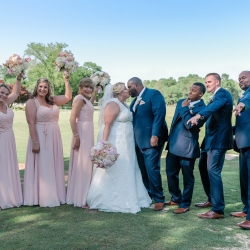 Bride and groom pose with their bridal party at Providence Country Club in Charlotte, North Carolina