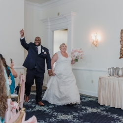 Bride and groom are all smiles as they are introduced into their wedding reception at Providence Country Club by Split Second Sound