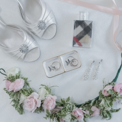 Bridal rings and other objects create a perfect flat lay of a spring wedding captured by Green Valley Photography