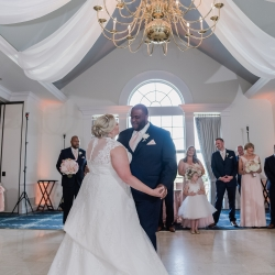 Bride and groom share a romantic first dance during their wedding reception at Providence Country Club