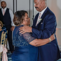 Grooms parents share a dance as the wedding party remembers the brides late mother all captured by Green Valley Photogrpahy