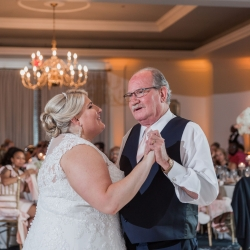 Bride shares a dance with her father during her wedding reception at Providence Country Club captured by Green Valley Photography