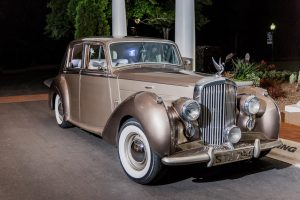 Queen City Party Charters provided a vintage Rolls Royce as the perfect getaway car for a wedding reception at Providence Country Club