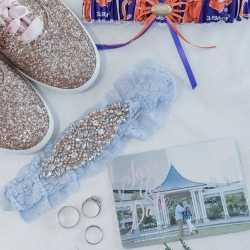 Custom Clemson garter and sparkler shows showed off the brides unique style all captured by Green Valley Photography for a spring wedding in Charlotte, North Carolina