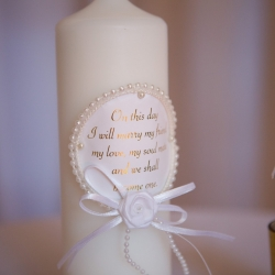 Sweet details of a unity candle show the love of a couple during a fall wedding coordinated by Magnificent Moments Weddings