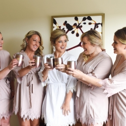 Bridal party shares a drink as they get ready for their fall wedding at Byron's South End