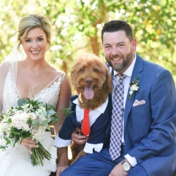 Bride and groom pose with their sweet dog for Indigo Photography