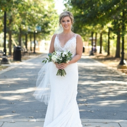 Bride is all smiles as she poses for Indigo Photography during her fall wedding in Uptown Charlotte