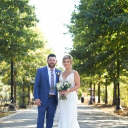Bride and groom pose for Indigo Photography during their fall wedding
