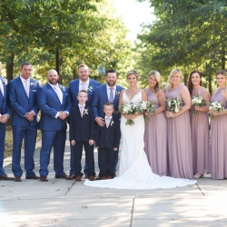Stunning bridal party is captured by Indigo Photography during a fall uptown wedding