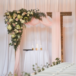 Stunning arch is draped with flowers by Heatherly Event Design