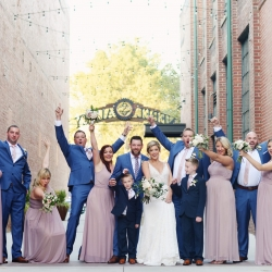 Bridal party poses for Indigo Photography during their fall wedding at Byron's South End
