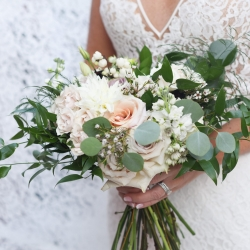 Stunning bridal bouquet featured blush roses created by Heatherly Event and Design