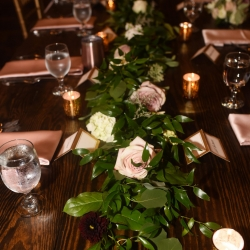 Floral garlands and blush roses were amazing centerpieces created by Heatherly Event and Design