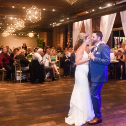 Indigo Photography captures a first dance between a bride and groom during their wedding reception at Byron's South End