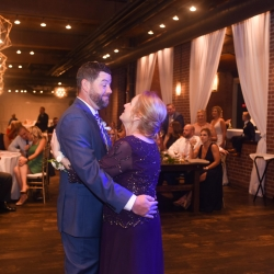 Groon shares a sweet dance with his mother during his wedding reception coordinated by Magnificent Moments Weddings