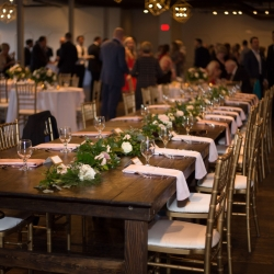 Farmhouse tables with white napkins showed a sweet elegance for a fall uptown wedding