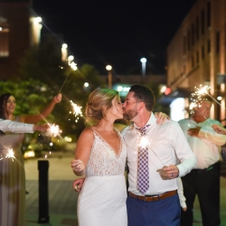 Indigo Photography captures a fun sparkler send off with a bride and groom during their wedding at Byron's South End