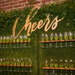 Champagne wall wowed guests during a fall wedding at Byron's South End