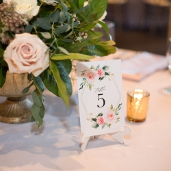 Floral table numbers are the perfect accent to a fall wedding captured by Indigo Photography