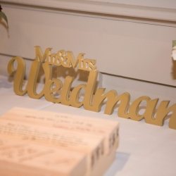 Custom signs show off the couples last name during their fall wedding at Byron's South End