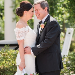 Bride and groom share a sweet moment during their spring wedding coordinated by Magnificent Moments Weddings