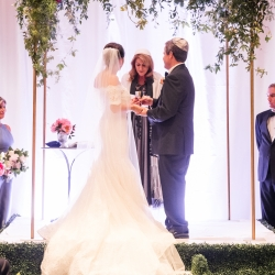 Bride and groom exchange vows during their spring wedding at The Ballantyne Hotel