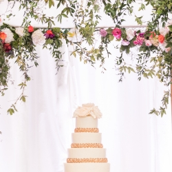 The Chuppah was draped in bright flowers and was the perfect backdrop for a stunning Kathy Allen Cake