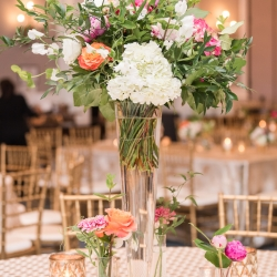 Bright floral centerpieces had such soft colors created by Proper Flower for a spring wedding at The Ballantyne Hotel