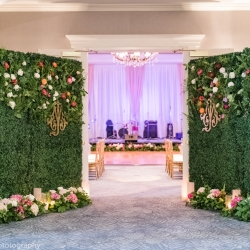 Greenery walls were the perfect accent welcoming guests into a spring reception at The Ballantyne Hotel