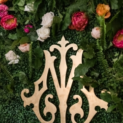 Custom monogram shows of the bride and grooms initials intertwined during a spring wedding coordinated by Magnificent Moments Weddings