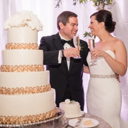 Bride and groom share a toast before cutting their stunning four tier cake created by Kathy Allen Cakes