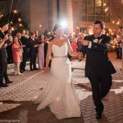 Bride and groom exit their Ballantyne Hotel wedding reception coordinated by Magnificent Moments Weddings